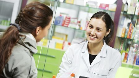 A pharmacist helping a customer. Picture: GETTY IMAGES/ISTOCKPHOTO