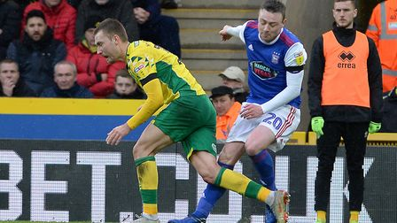 Fredie Sears injures his knee in this first half collision at Norwich. Picture Pagepix