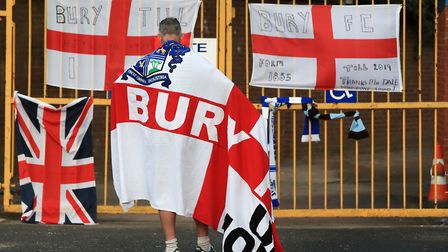 A Bury fan at the gates of Gigg Lane, after the Greater Manchester club was expelled from the EFL. P
