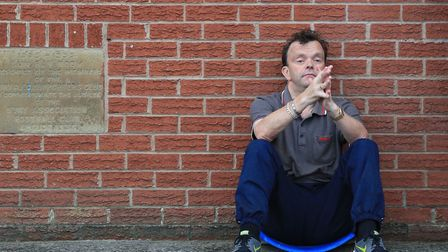 A dejected fan outside Gigg Lane, after the club were kicked out of the football league. Picture: PA