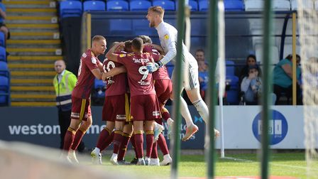 Ipswich celebrate after Luke Chambers scores a last gasp equaliser at Peterborough Picture: PAGEPIX