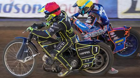 Chris Harris tries the inside run on Nico Covatti when Poole and Ipswich lasst met. Picture: Stev