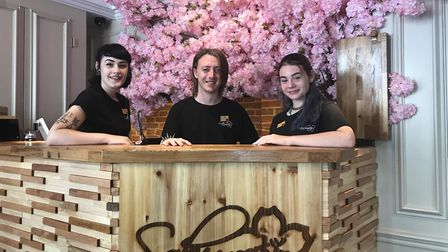 Staff members, Esha Copping (left), Bev Piercy (centre) and Sophie Swann (right), at Bury's new Japa