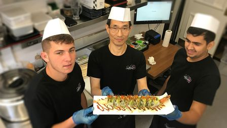 Chefs, Vlad Casian (left), Xinge Chen (middle) and Andre Nutea (right), with a plate of freshly prep