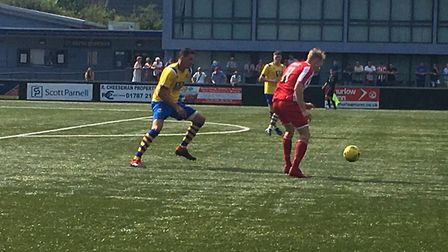 Felixstowe & Walton's Armani Schaar on the ball during the early stages of this afternoon's FA Cup t