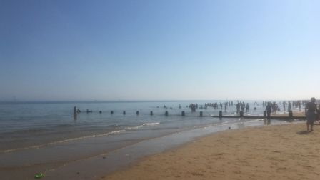 A warning tape is set at the beach in Frinton, Essex, as emergency services received several reports