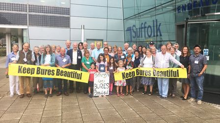 Bures villagers protest outside Babergh District Council's offices in Ipswich at plans for homes in