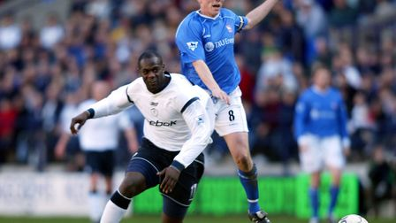 Ipswich Town skipper Matt Holland grapples with Bolton's Michael Ricketts during Town's 4-1 defeat i
