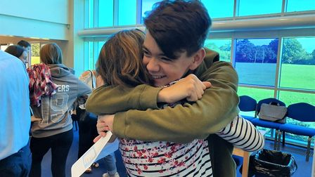 Milo Parker and his mother shared a tender moment after finding out his GCSE grades. Picture: GEMMA