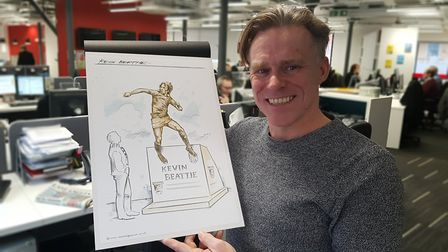 Sculptor Sean Hedges-Quinn with his design for the Kevin Beattie statue Picture: Neil Perry