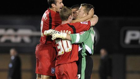Ipswich Town players celebrate a League Cup penalty shootout win at Shrewsbury in 2009. Photo: PA