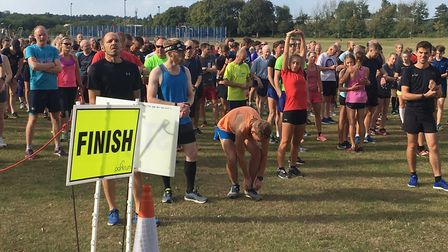 Runners limber up, or relax, before the start of last Saturday's Sloughbottom parkrun, in Norwich. P