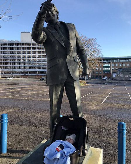 Stephen Bailey'�s son Robson at two weeks old with the Sir Bobby Robson statue. Picture: STEPHEN BAI