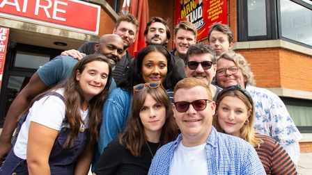 Philip Tomlin as Francis Henshall, with the cast of the fast-paced comedy One Man, Two Guvnors which