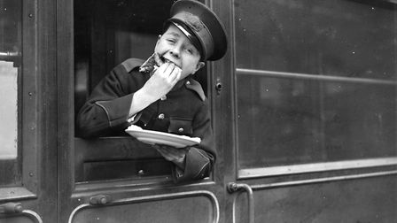 A young lad enjoys a pancake after they were distributed to staff at Liverpool Street Station. Food