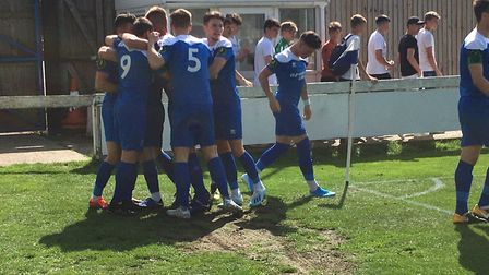 Bury Town players celebrate Cemal Ramadan's opening goal, scored after just two minutes against Basi