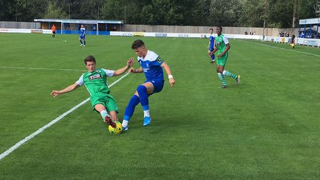 Ross Crane, on the ball, one of five players who made their full debuts for Bury Town, against Basil