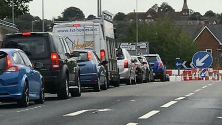 Gridlock on Ipswich Road could be eased if the �99m investment for a new town near Colchester can be