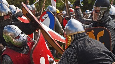 Re-enactors recreate the sight and sounds of the medieval battlefield as part of the Colchester Cast