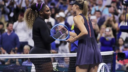 Serena Williams, left, shakes hands with Maria Sharapova after their first-round match at the U.S. O
