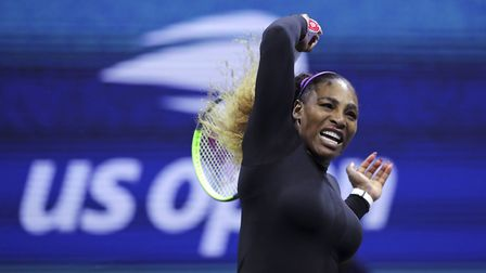 Serena Williams returns to Maria Sharapova during the first round of the U.S. Open tennis tournament