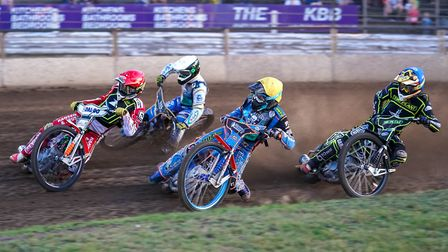 Niels-Kristian Iversen (red helmet), and Nico Covatti (yellow) battle ahead of Jack Holder (white) a