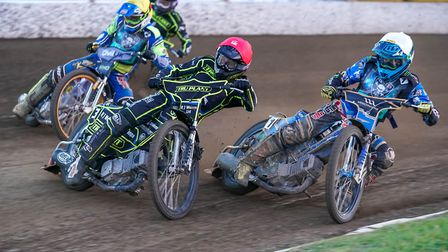 Ipswich's Danny King leads Poole's Jack Holder (white helmet) and Richie Worrall. Both teams should