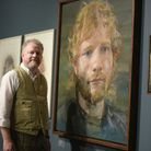 Artist Colin Davidson next to his portraits of Ed Sheeran Picture: SARAH LUCY BROWN