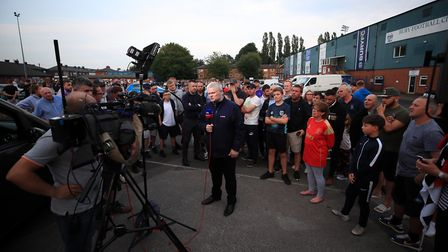 Sky Sport News presenter Alan Myers is surrounded by Bury fans at Gigg Lane in the hours before the