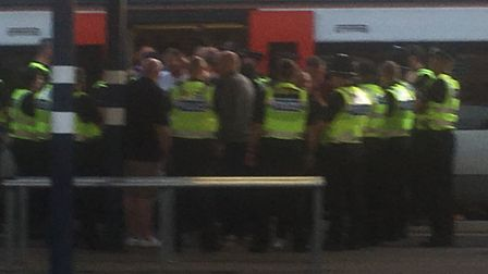 Police pictured at Peterborough railway station on Saturday, where there was a reported disturbance