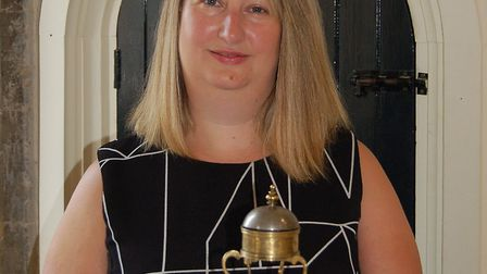 Joanna Rayner with the historic Drum Clock made in Prague in 1540 and stolen 55 years ago which has