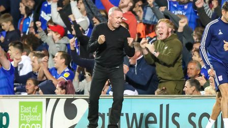Town manager Paul Lambert celebrates the 2-1 victory over AFC Wimbledon. Picture: STEVE WALLER
