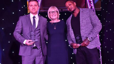 The Unsung hero of the Year Award is presented by Lesley Dolphin to Steve Cates and Antwonne Smith