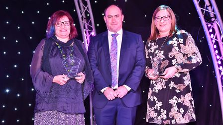 Lisa Barrell and Kate Mason are presented with the Outstanding Bravery of the Year Award by Liam Be