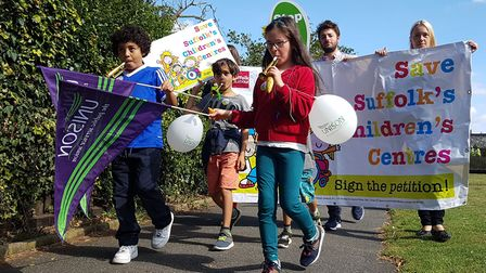 A large crowd marched through Woodbridge to protest against the closure of children's centres PICTUR