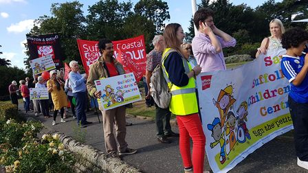 Protesters march through Woodbridge at the decision to cut children's centres in Suffolk. PICTURE: R