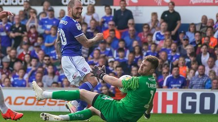 Doncaster Rovers keeper Ian Lawlor saves this James Norwood effort. Picture: Steve Waller www.