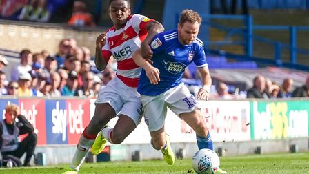 Alan Judge battling with Niall Ennis in the second half. Picture: Steve Waller www.stephenwall