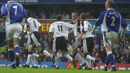 A delighted John McGreal celebrates his first Ipswich Town goal, during the 3-0 win at Everton in Se