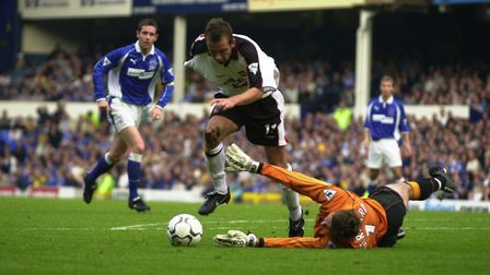Marcus Stewart pounces on a poor back pass to beat Everton keeper Paul Gerrard, during Town's 3-0 wi