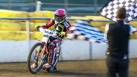 Niels-Kristian Iversen takes the chequered flag to win the opening heat in a new track record. Pi