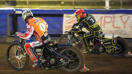 Chris Harris goes round Jason Doyle to re-pass the the former world champion in heat five. Pictur