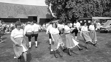 Swing your partner round and round - some summer country dancing Picture: IAN HULLAND