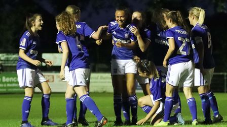 Town players celebrate with Paige Peake in the East Anglian Derby Picture: ROSS HALLS