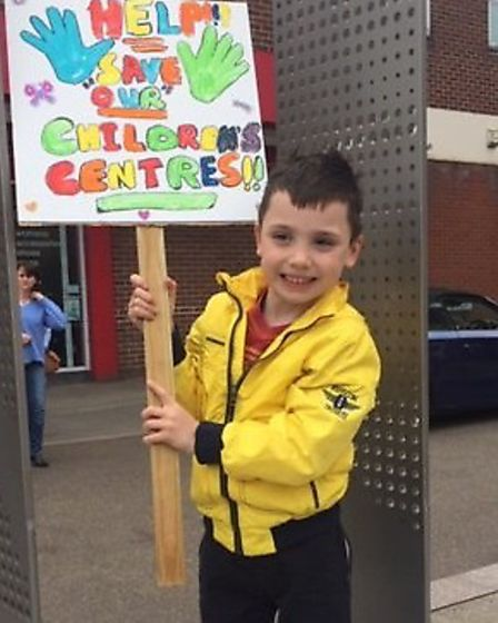 Kai Fitzgerald taking part in the Newmarket day of action on children's centres. Picture: KEVIN YARR