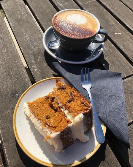 Liz's carrot cake and cappucino at the Folk Cafe. Rich and generous!