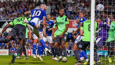 James Norwood heads Town level at 1-1 against AFC Wimbledon. Picture: STEVE WALLER WWW.STEPHE