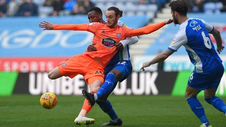 Will Keane tries to turn and shoot early on at Wigan last season Picture Pagepix