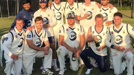 Frinton-on-Sea's first-team squad celebrate winning the East Anglian Premier League title, following
