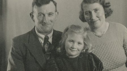 Young Hazel with her father, Ted, and mother Peg Picture: FAMILY COLLECTION